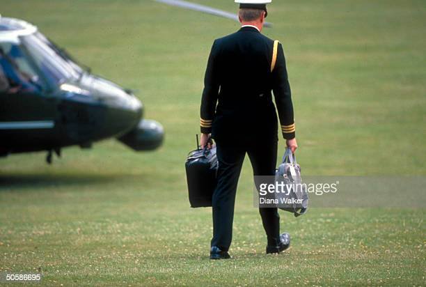 Football carrier heading for copter to be nr Pres Bush during Houston TX Economic Summit