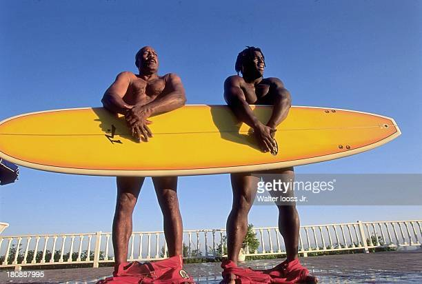 Casual portrait of Hall of Famer and former Cleveland Browns player Jim Brown and New Orleans Saints running back Ricky Williams posing with pants...