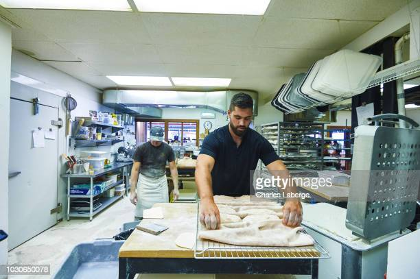 Casual portrait of Kansas City Chiefs offensive guard Laurent DuvernayTardif kneading dough at his bakery Le Pain dans les Voiles DuvernayTardif...