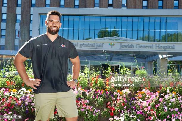 Casual portrait of Kansas City Chiefs offensive guard Laurent DuvernayTardif posing during photo shoot in front of Jewish General Hospital...
