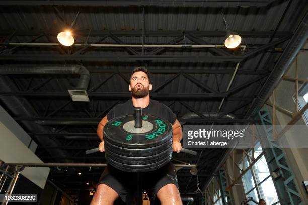 Casual portrait of Kansas City Chiefs offensive guard Laurent DuvernayTardif lifting weights during training session photo shoot DuvernayTardif...