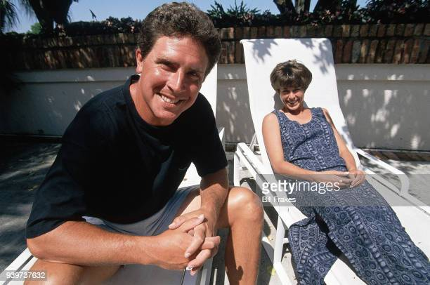 Casual portrait of Miami Dolphins QB Dan Marino and his wife Claire posing poolside during photo shoot at their home Miami FL CREDIT Bill Frakes