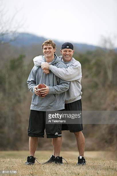 Football Casual portrait of NFL prospect and former Virginia defensive end Chris Long getting hug from his father former NFL player and Hall of Famer...