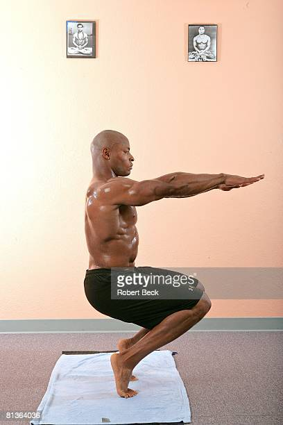 Football Casual portrait of San Francisco 49ers Tony Parrish in action demonstrating Bikram yoga awkward posture during workout Santa Clara CA...