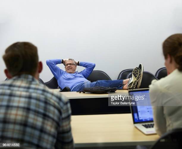Casual portrait of Sports Illustrated senior writer and MMQB managing editor Peter King in conference room during edit meeting at Meredith offices at...