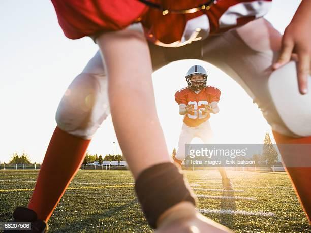 Football center preparing to snap football to quarterback