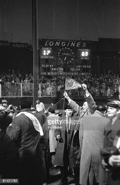 Football championship Baltimore Colts fans victorious pennant after game vs New York Giants View of scoreboard at Yankee Stadium Bronx NY