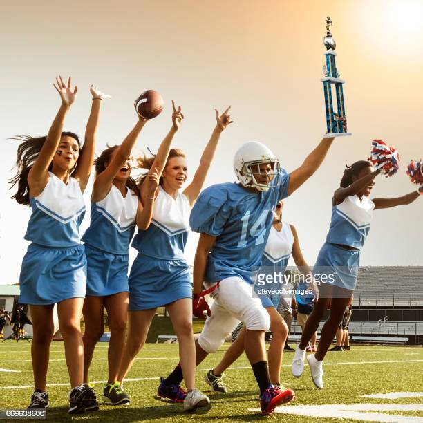 football cheerleaders & player - black cheerleaders stock photos and pictures
