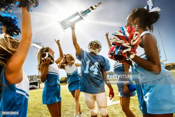 football cheerleaders & player - cheerleaders stock photos and pictures