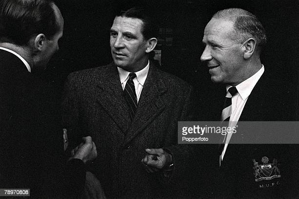 Football Chelsea manager Ted Drake and Manchester United manager Matt Busby talk with Wally Barnes as they agree with reservations that Amateur Cup...