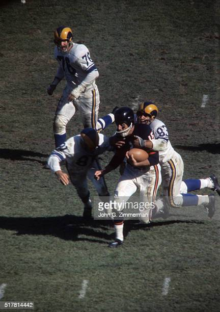 Chicago Bears Ed Brown in action rushing under pressure vs Los Angeles Rams Tom Franckhauser and Lou Michaels at Wrigley Field Chicago IL CREDIT John...