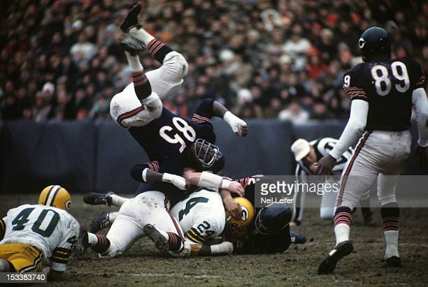 Chicago Bears Emilio Vallez and Willie Holman in action tackle vs Green Bay Packers Willie Wood at Soldier Field Chicago IL CREDIT Neil Leifer