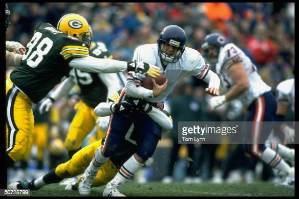Chicago Bears QB Jim Harbaugh in action vs Green Bay Packers Tony Bennett and David Grant