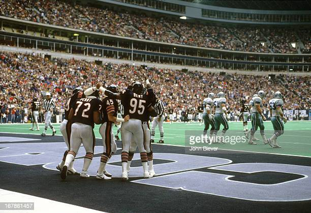 Chicago Bears Richard Dent victorious with William The Refrigerator Perry Gary Fencik and teammates in endzone after scoring touchdown during game vs...