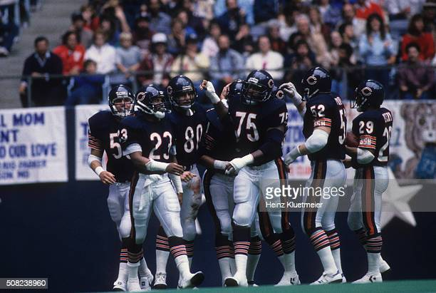 Chicago Bears Ron Rivera Shaun Gayle Tim Wrightman Stefan Humphries Cliff Thrift and Dennis Gentry victorious on field after touchdown during game vs...