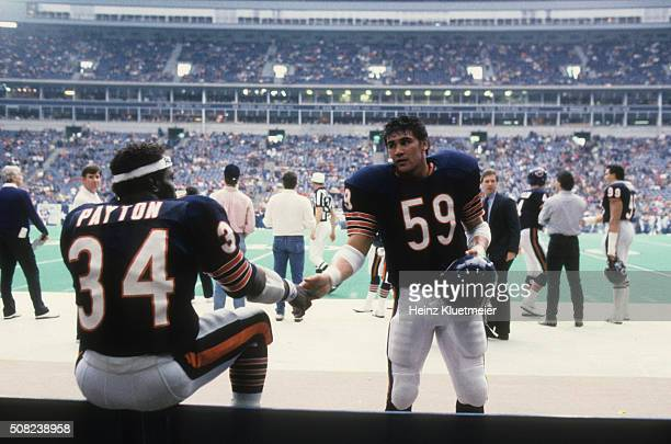 Chicago Bears Ron Rivera victorious with Walter Payton on sidelines during game vs Dallas Cowboys at Texas Stadium Irving TX CREDIT Heinz Kluetmeier
