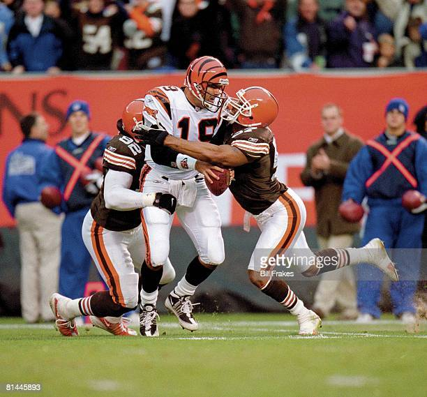Football Cincinnati Bengals QB Scott Mitchell in action getting sacked vs Cleveland Browns Courtney Brown and Dwayne Rudd Cleveland OH