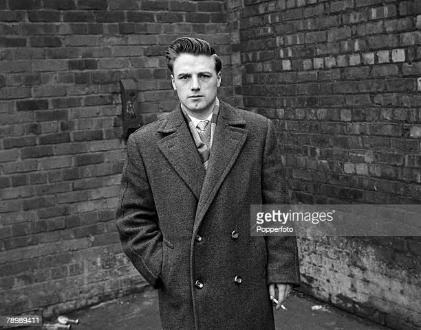 Football Circa 1950's Manchester United's Albert Scanlon in a long coat holding a cigarette