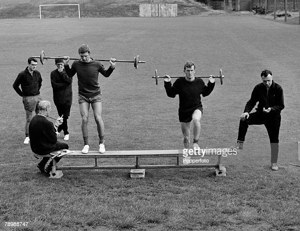 Football, Circa 1960's, Manchester United training, Manchester United's Brian Kidd and Alex Stepney in weightlifting exercises