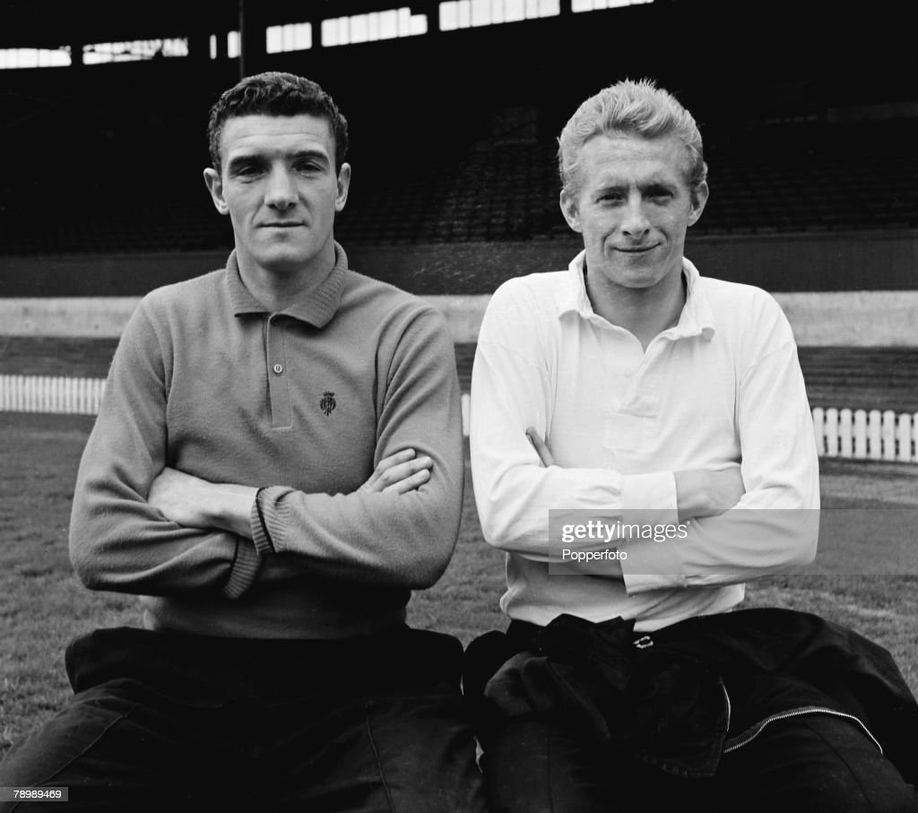 Football. Circa 1960's. Manchester United's Dennis Law and Bill Foulkes ( left) sit together on a bench. : News Photo