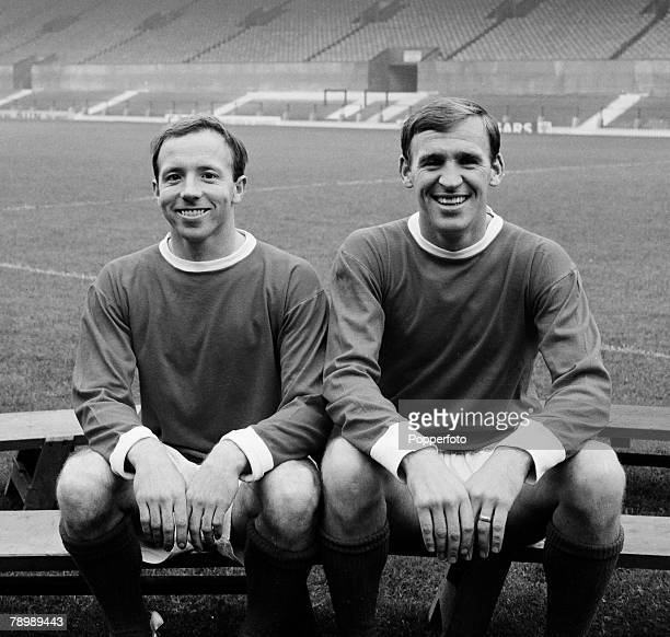 Football, Circa 1960's, Nobby Stiles and Pat Crerand of Manchester United sit together on a bench,