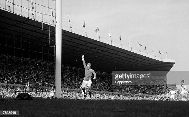 Football Circa 1960's Old Trafford Manchester Dennis Law of Manchester United celebrates a goal with the stadium and crowds in the background