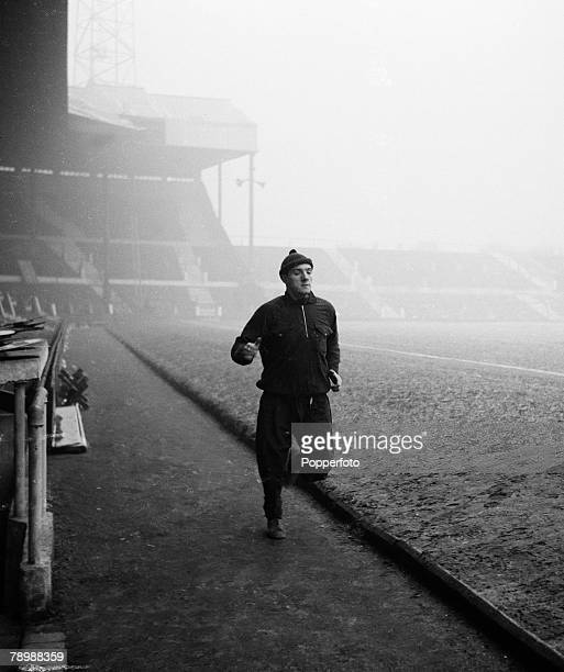 Football, Circa 1960's, Old Trafford, Manchester, Manchester United's Bill Foulkes runs around the outside of the pitch on a training run