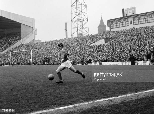 Football, Circa 1960's, Old Trafford stadium, Francis Burns of Manchester United about to kick the ball with the crowd and grandstand in the...
