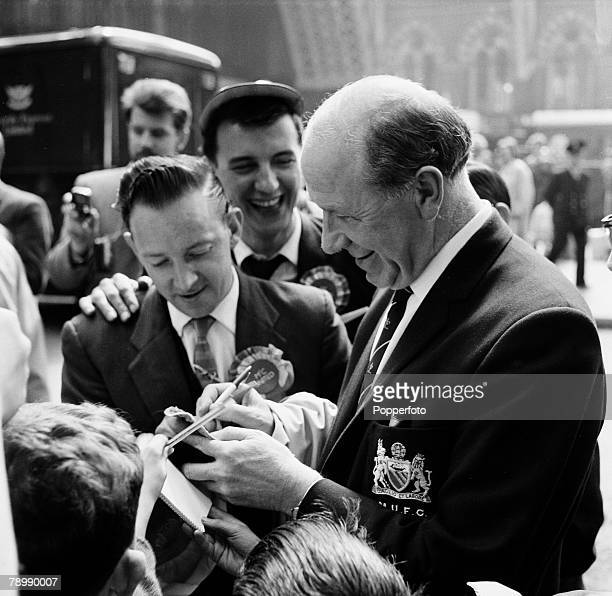 Football Circa 1964 Old Trafford Manchester England Manchester United manager Matt Busby signs autographs outside the stadium