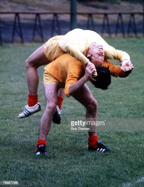 Football, Circa 1970, Manchester United's Bobby Charlton stretches during training exercises