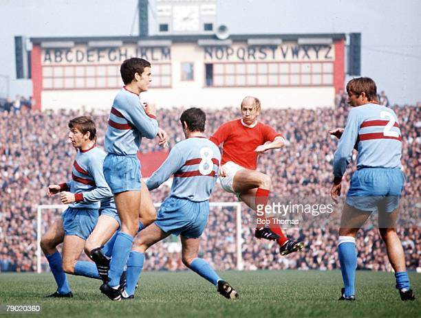 Football Circa 1970's Manchester United's Bobby Charlton shoots through a crowd of West Ham players including Martin Peters and Trevor Brooking...