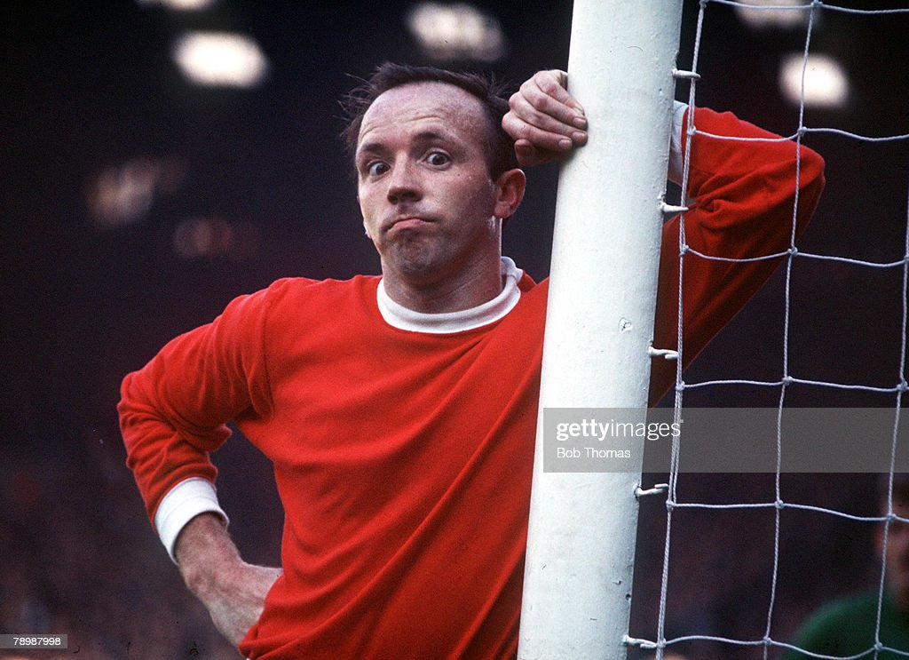 Football. Circa 1970's. Manchester United's Nobby Stiles stares into the camera as he leans on a goal post. : News Photo