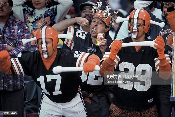 Cleveland Browns Dawg Pound fans in stands during game vs Tampa Bay Buccaneers One fan is eatting from an Alpo dog food can Cleveland OH 9/10/1995...