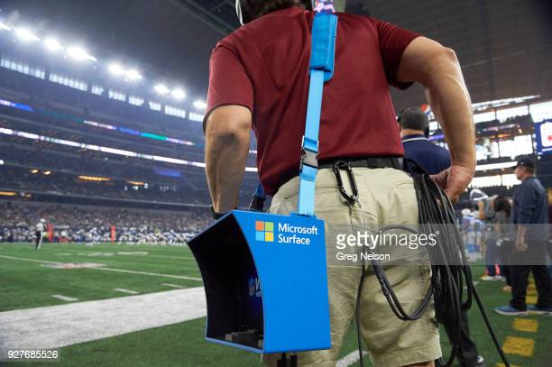 Closeup of assistant coach holding Microsoft Surface video equipment on sidelines during Dallas Cowboys vs Los Angeles Chargers game at ATT Stadium...