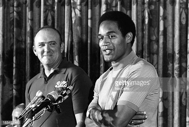 Closeup of Buffalo Bills head coach coach John Rauch and OJ Simpson during training camp at Niagara University Lewiston NY CREDIT Neil Leifer