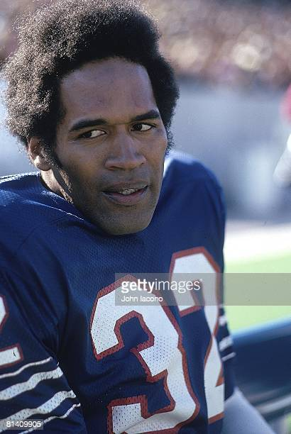 Football: Closeup of Buffalo Bills O,J, Simpson on sidelines bench during game vs Baltimore Colts, Orchard Park, NY