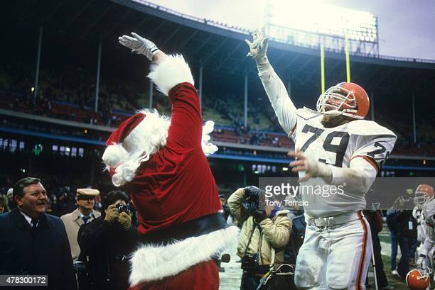 Closeup of Cleveland Browns Clayton Beauford victorious highfiving with man in Santa Claus costume on sidelines during game vs Cincinnati Bengals at...