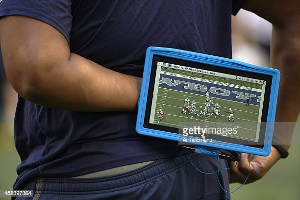 Closeup of Dallas Cowboys coach holding Microsoft Surface tablet on sidelines during game vs Arizona Cardinals at ATT Stadium Arlington TX CREDIT Al...