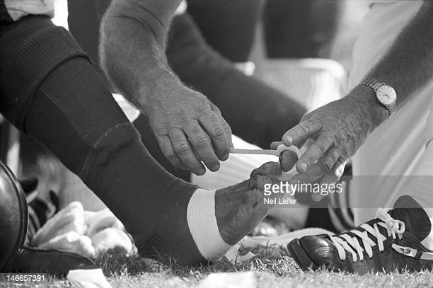Closeup of foot of Los Angeles Rams player being wrapped on sidelines bench during game vs New Orleans Saints at Tulane StadiumNew Orleans LA...