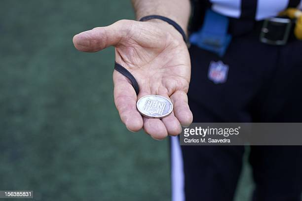 Closeup of hand of NFL referee Ron Winter holding coin for toss before Baltimore Ravens vs Oakland Raiders game at MT Bank Stadium Baltimore MD...