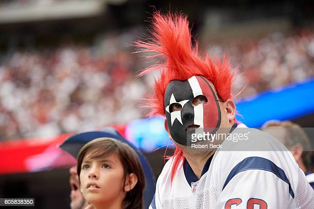 Closeup of Houston Texans fan in stands wearing mask with team colors during game vs Chicago Bears at NRG Stadium Houston TX CREDIT Robert Beck