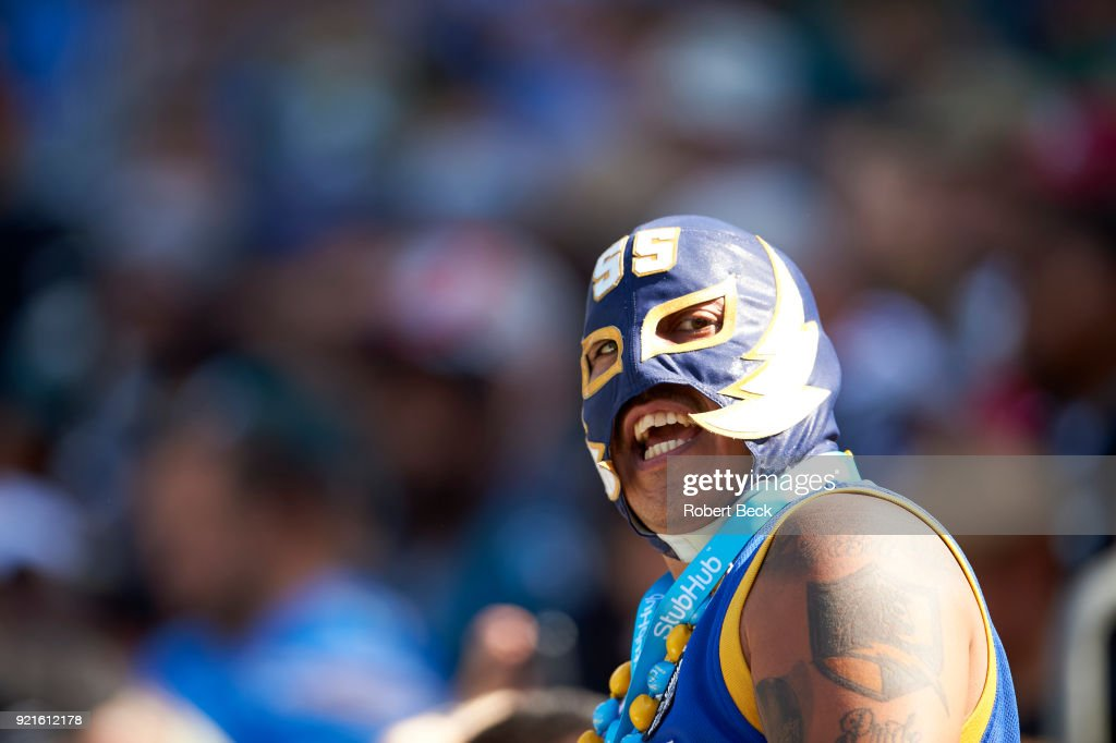 Closeup of Los Angeles Chargers fan wearing mask in stands during game vs Philadelphia Eagles at StubHub Center. Robert Beck TK1 )