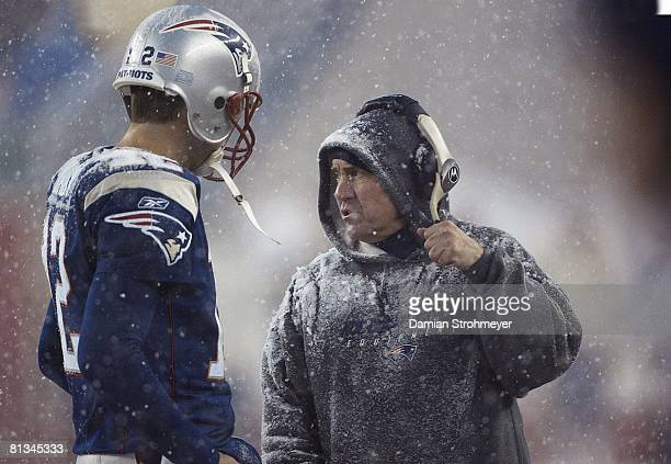 Football Closeup of New England Patriots coach Bill Belichick and QB Tom Brady during game with snow vs Jacksonville Jaguars Foxboro MA