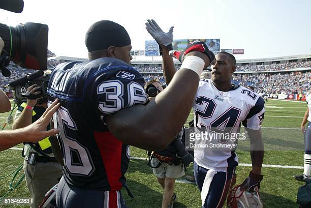 Football: Closeup of New England Patriots Ty Law with Buffalo Bills Lawyer Milloy after game, Orchard Park, NY 9/7/2003