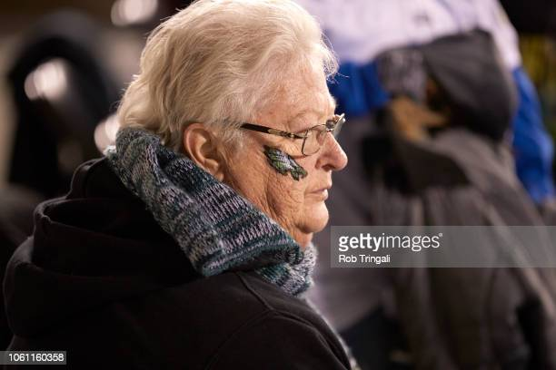 Closeup of Philadelphia Eagles female fan in stands with Eagles logo painted on face during game vs Dallas Cowboys at Lincoln Financial Field...