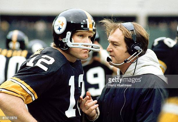 Football Closeup of Pittsburgh Steelers coach Chuck Noll with QB Terry Bradshaw on sidelines during game vs Cleveland Browns Pittsburgh PA 12/3/1972