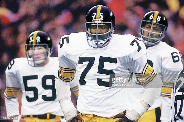 Football Closeup of Pittsburgh Steelers Jack Ham Joe Greene and LC Greenwood during game vs New York Giants Flushing NY