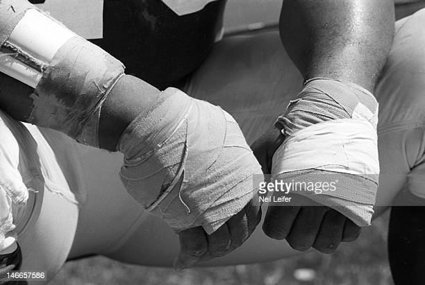 Closeup of wrapped hands of Los Angeles Rams Roger Brown on sidelines bench during game vs New Orleans Saints at Tulane Stadium.New Orleans, LA...