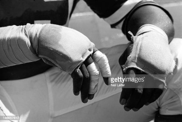Closeup of wrapped hands of Los Angeles Rams Roger Brown on sidelines bench during game vs New Orleans Saints at Tulane StadiumNew Orleans LA...