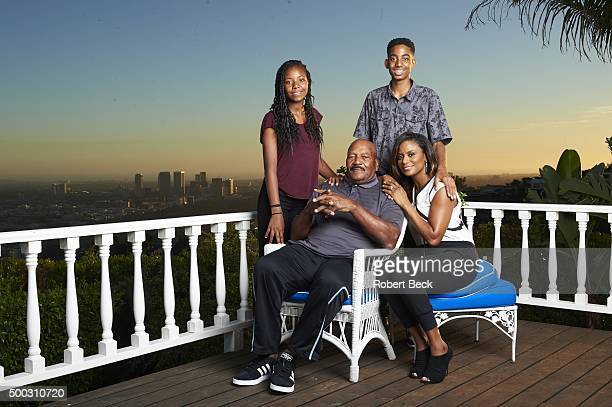 Closeup portrait of former Cleveland Browns running back and NFL Hall of Famer Jim Brown posing with his daughter Morgan, son Aris, and wife Monique...